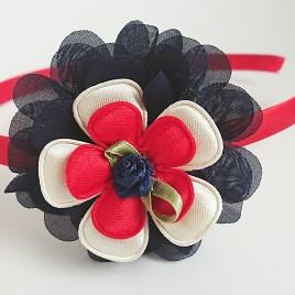 Diadeem rood, donkerblauwe bloem