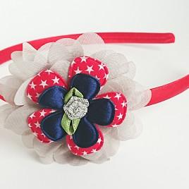 Diadeem rood, grijze bloem